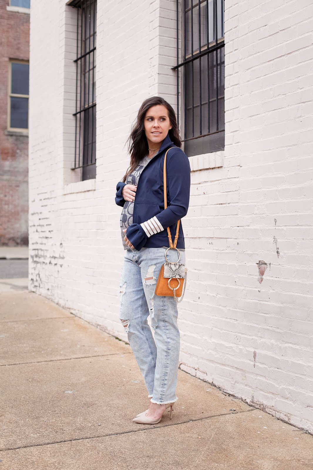 How to style a track jacket while pregnant.
