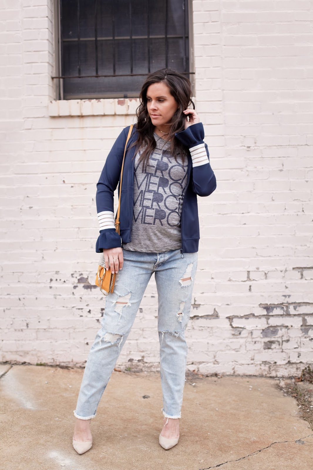 Distressed jeans and a track jacket