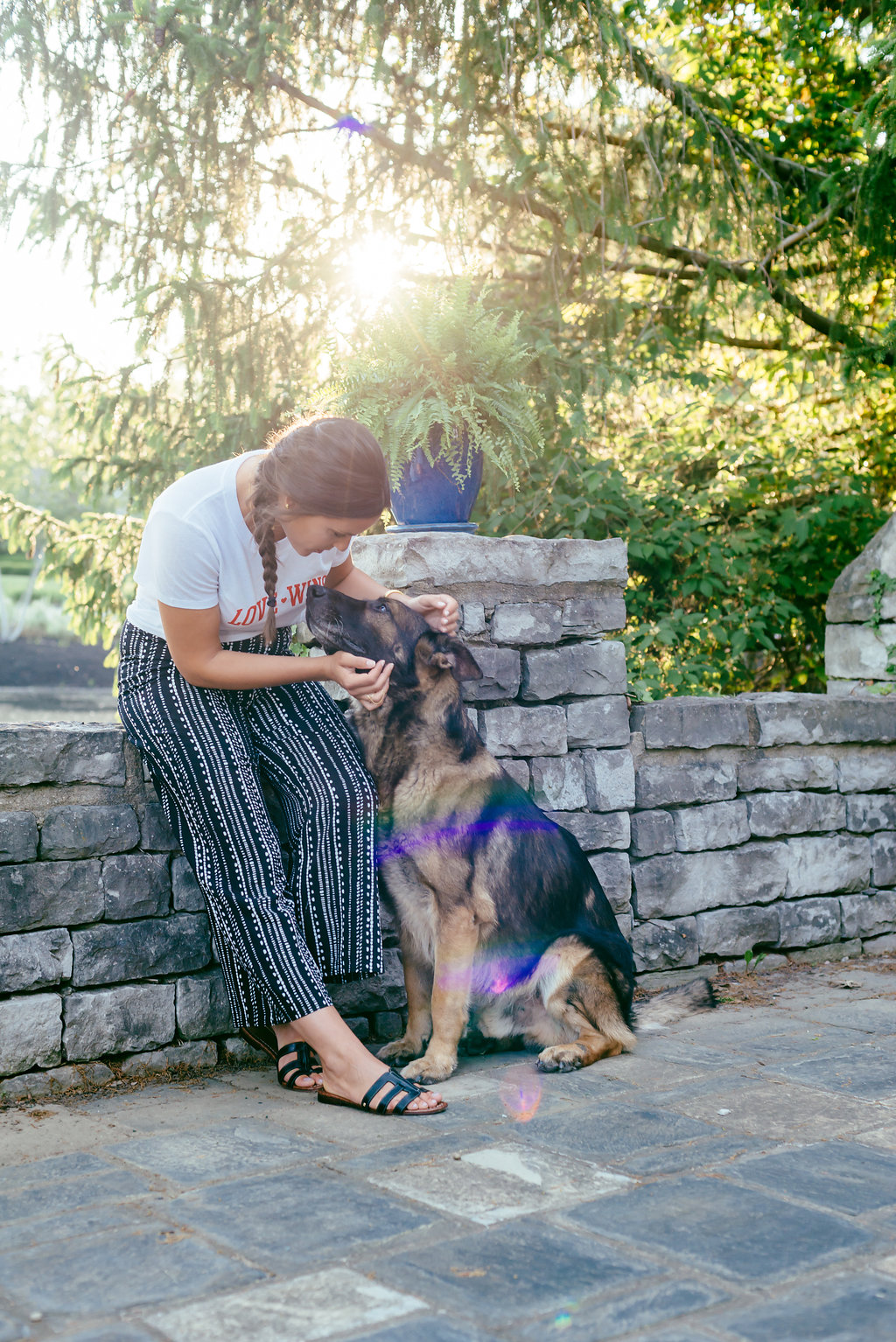 Love wins knotted tee and wide leg trousers and her german shepherd